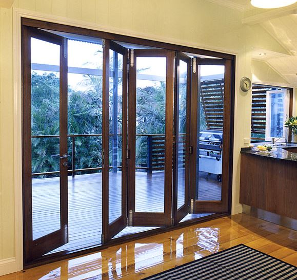 Exterior folding door hardware systems
